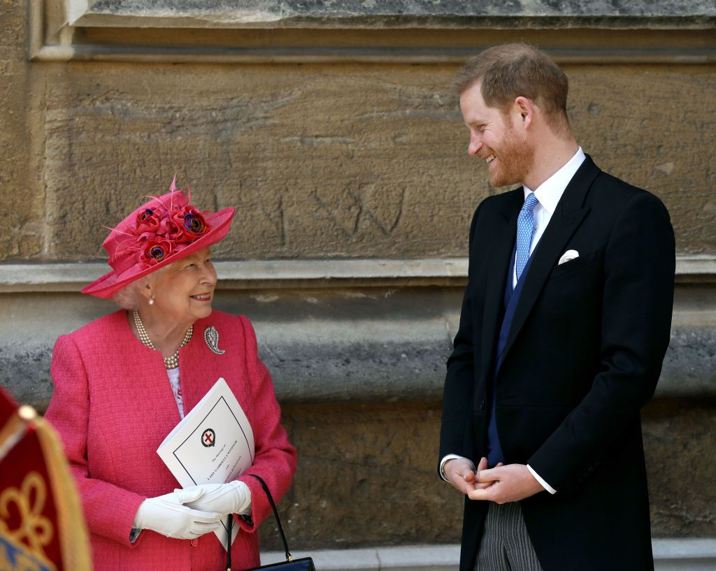 Queen Elizabeth II speaks with Prince Harry after the wedding of Lady Gabriella Windsor to Thomas Kingston on May 18, 2019, in Windsor, England | Photo: Steve Parsons - WPA Pool/Getty Images