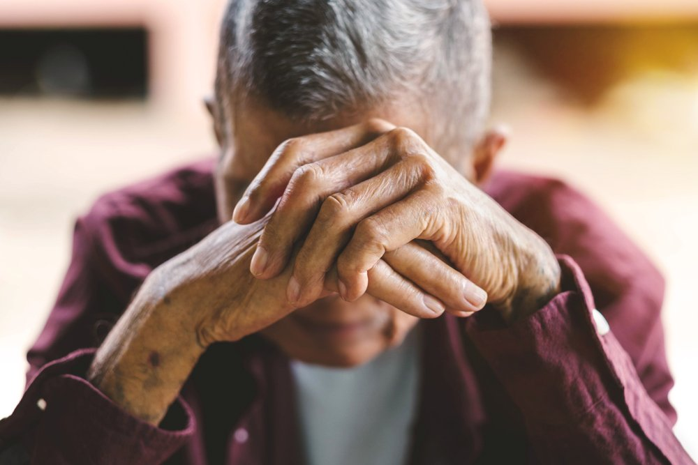 An embarrassed senior man covering his face with his hands. | Photo: Shutterstock
