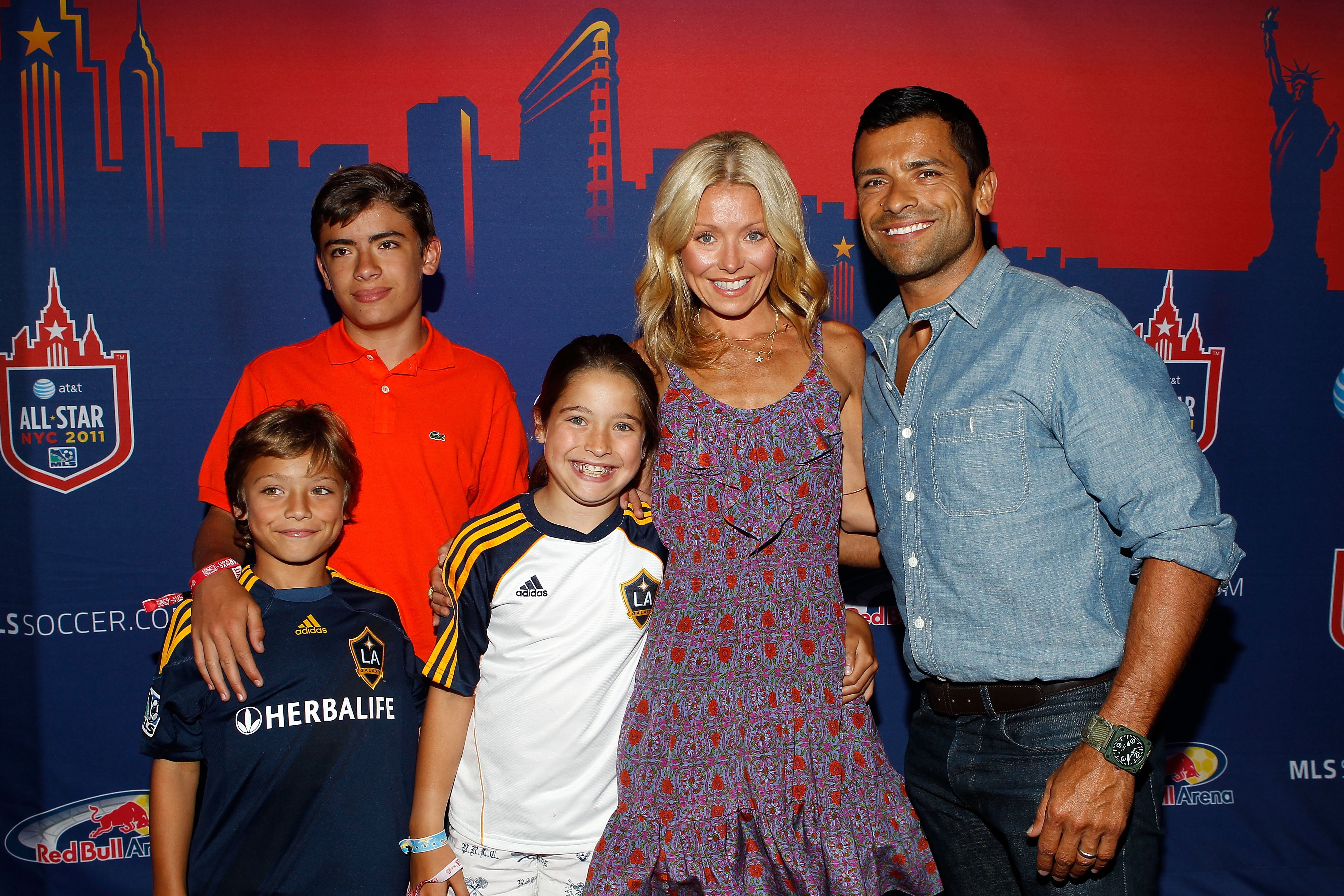 Kelly Ripa (2nd R), her husband Mark Consuelos (R) and their kids smiles for a photo prior to the MLS All-Star Game at Red Bull Arena on July 27, 2011 in Harrison, New Jersey. | Source: Getty Images