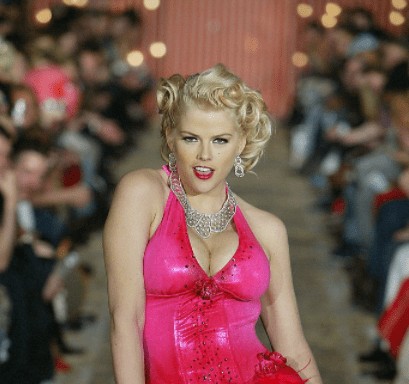 Anna Nicole Smith walks the runway at the Heatherette fashion show on February 12, 2004 during Olympus 2004 Fashion Week, in New York City. | Source: Getty Images