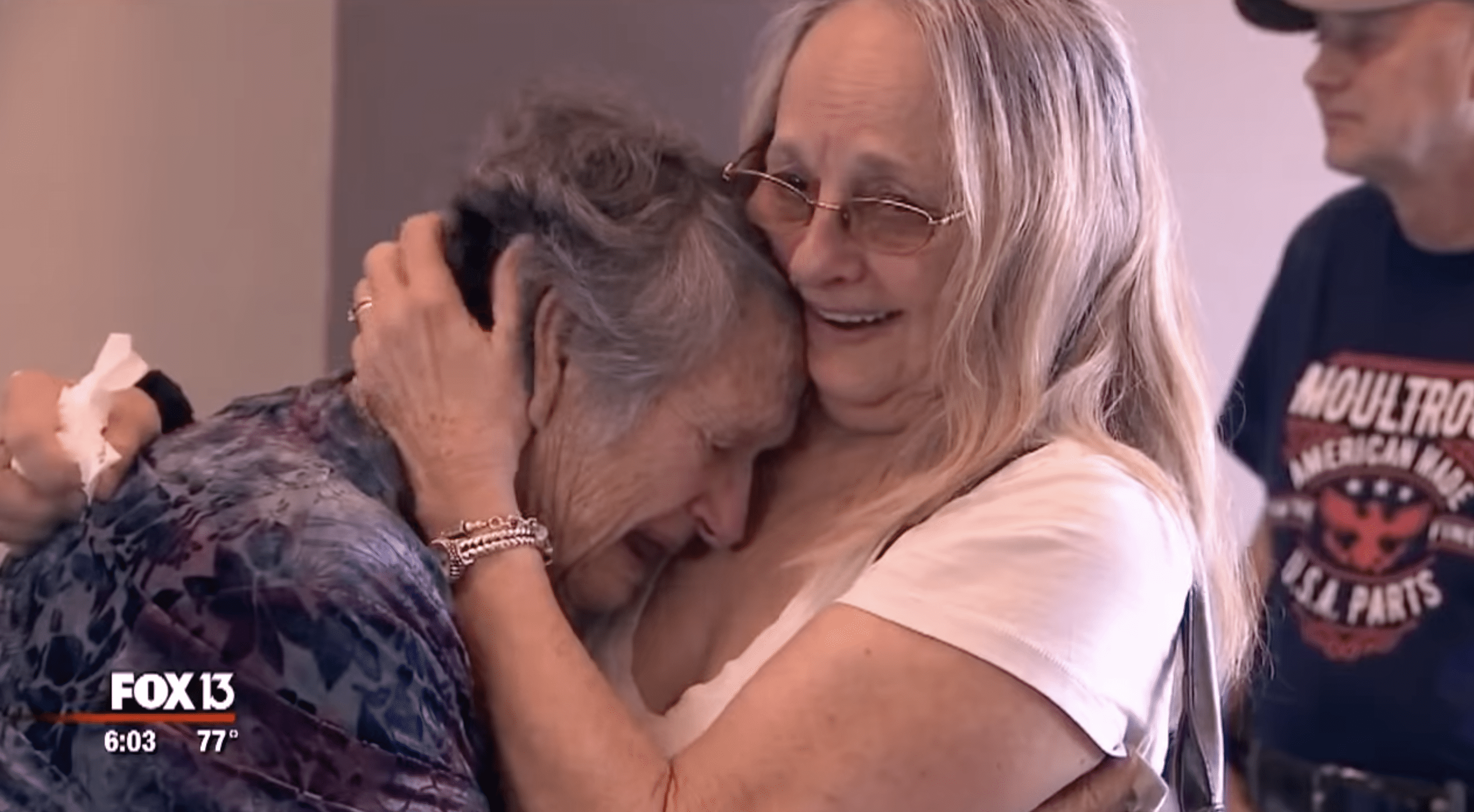 Purinton and Moultroup share a warm hug after years of separation. | Photo: youtube.com/FOX 13 Tampa Bay