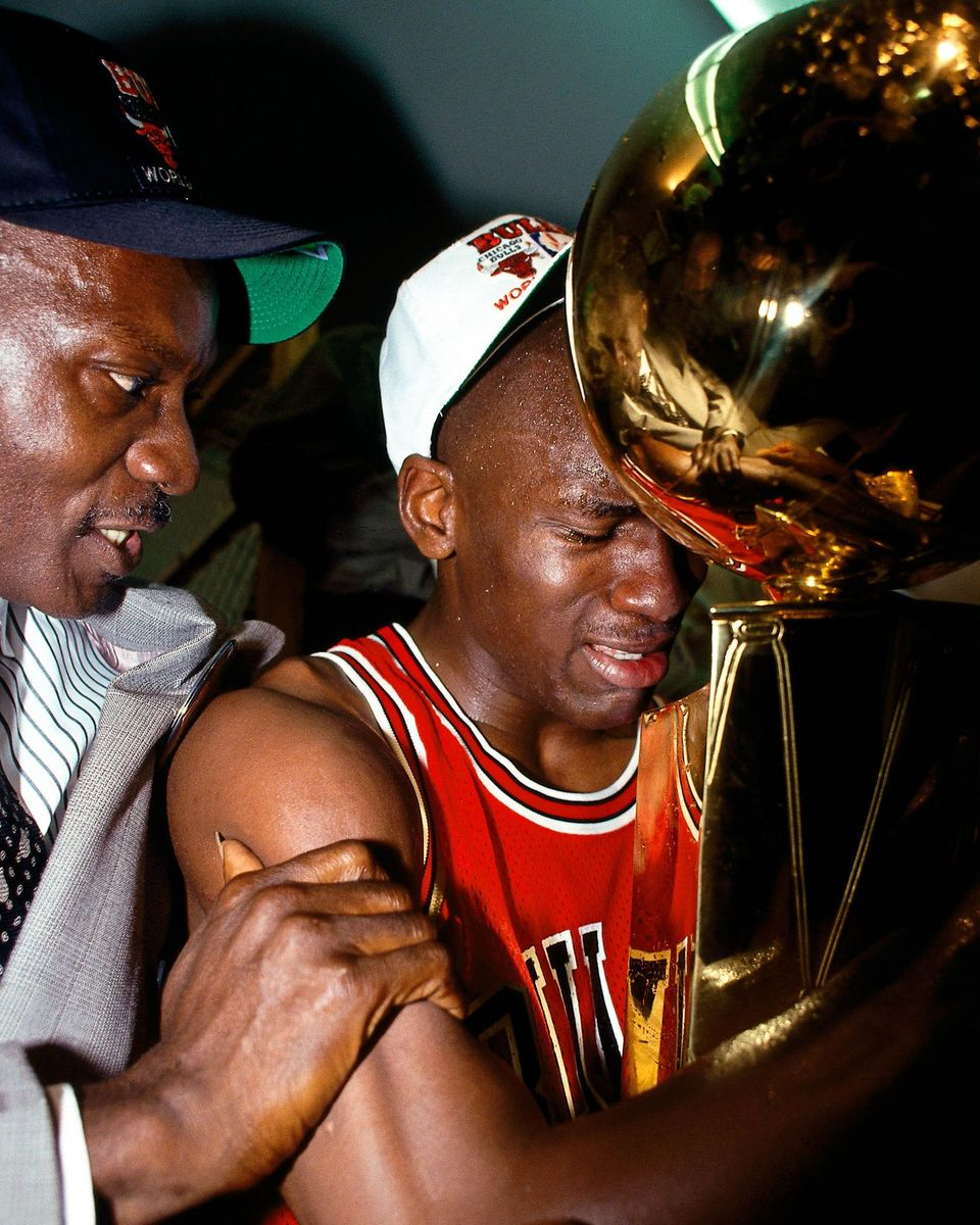 Michael Jordan with his father James Jordan during Game 5 the 1991 NBA Championship Finals against the Los Angeles Lakers at the Great Western Forum in Inglewood, California. | Source: Getty Images