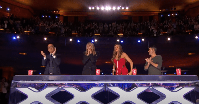 The AGT judges give Mauser a standing ovation after his emotional performance | Source: YouTube/AmericasGotTalent