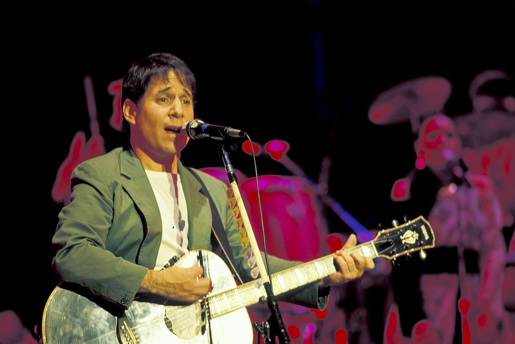 Paul Simon plays guitar during the tour in support of his 'Graceland' album on stage at the Jones Beach Theatre, Wantagh, New York, July 6, 1987. | Photo: Getty Images