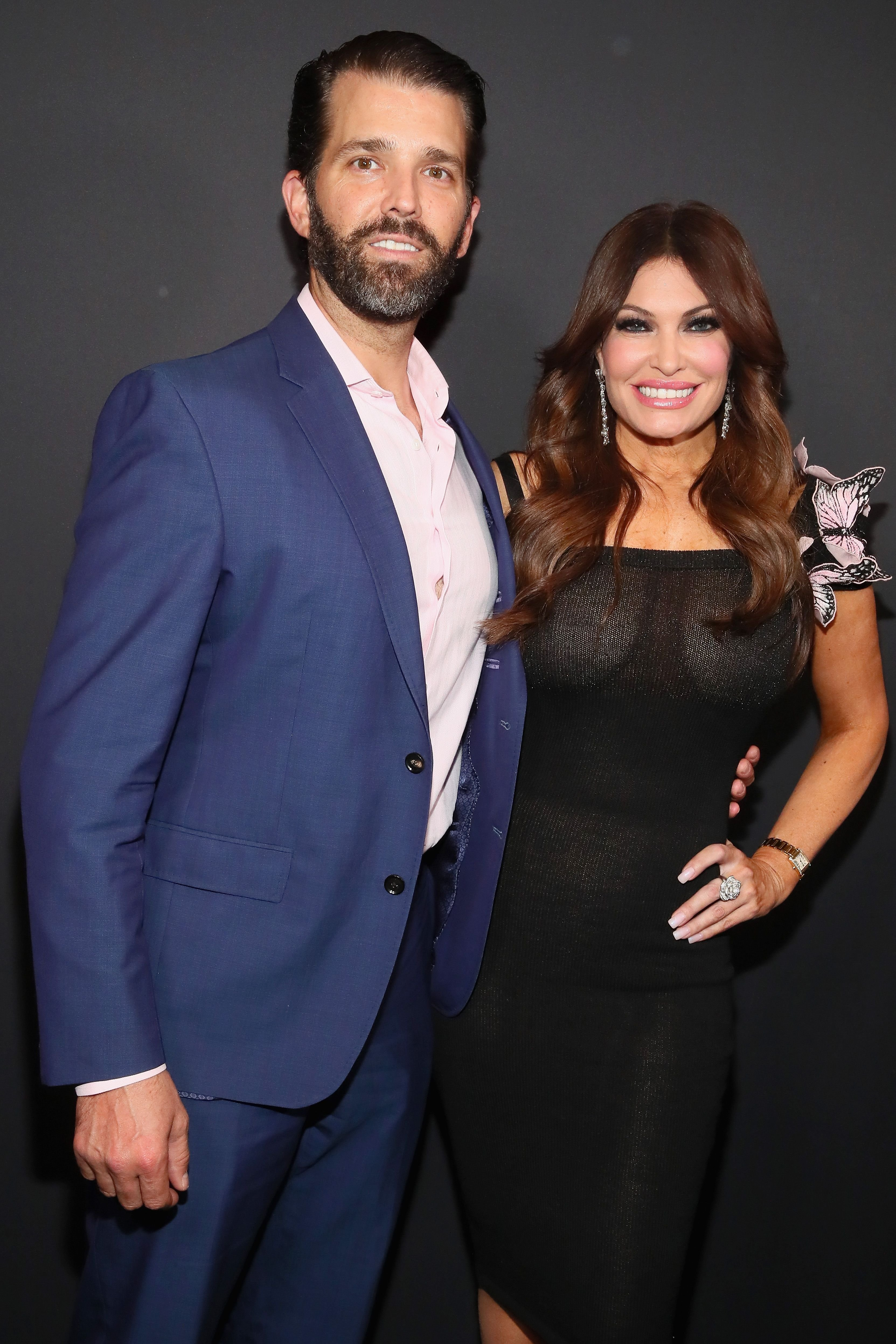 Kimberly Guilfoyle and Donald Trump Jr posing backstage for the Zang Toi fashion show during the New York Fashion Week at Spring Studios in New York City | Photo: Astrid Stawiarz/Getty Images for NYFW: The Shows