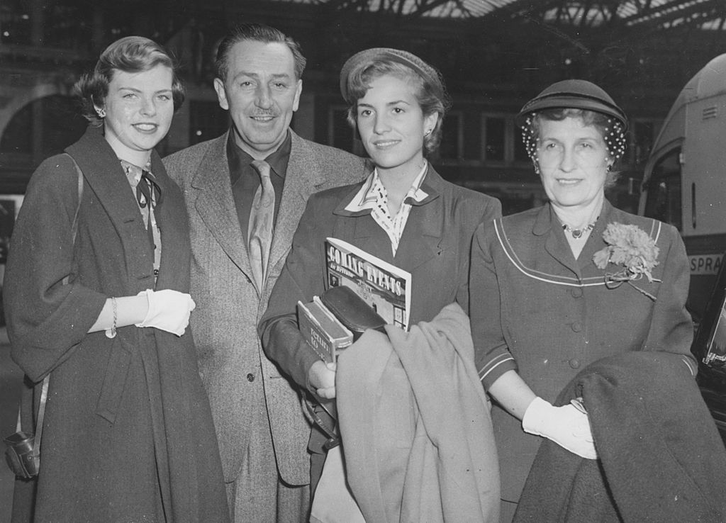 Walt Disney, creator of Mickey Mouse, with his wife and two daughters at Waterloo station after arriving on the Queen Mary boat train | Getty Images