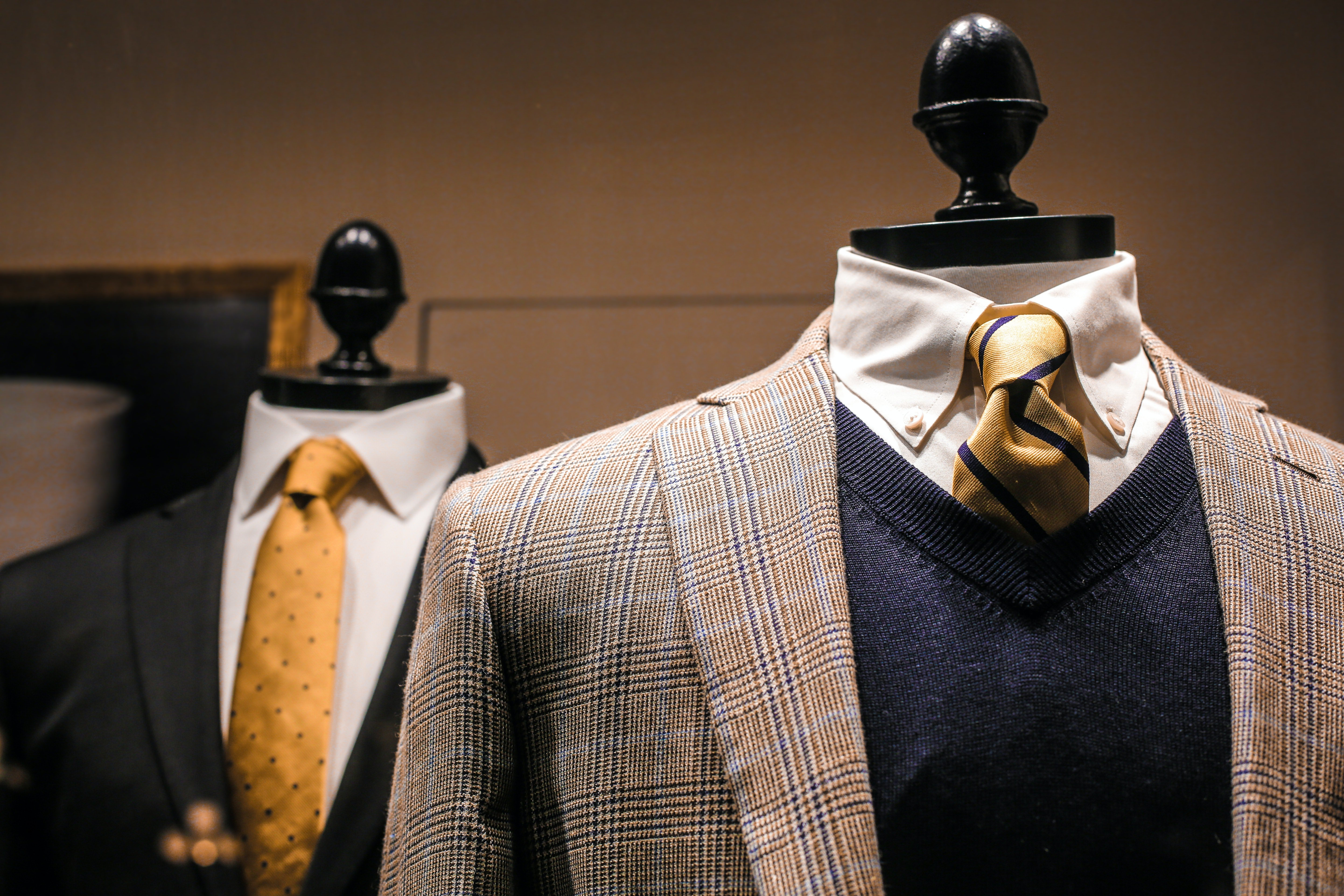 Pictured - Male outfits on dummies in a modern boutique   Source: Pexels