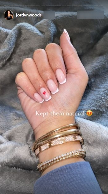A picture of Jordyn Woods showing off her nails and expensive bracelets.   Photo: Jordynwoods