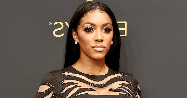 RHOA Star Porsha Williams Stuns Showing Her Fit Figure in Black Top and Tight Skirt with a Slit