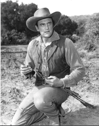 """James Arness on the set of """"Gunsmoke""""   Source: Getty Images"""