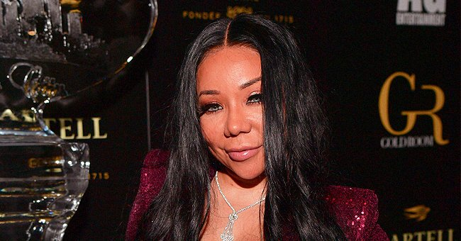 Tiny Harris Dotes on Her Granddaughter While She Drinks Milk from a Bottle in Adorable New Snaps