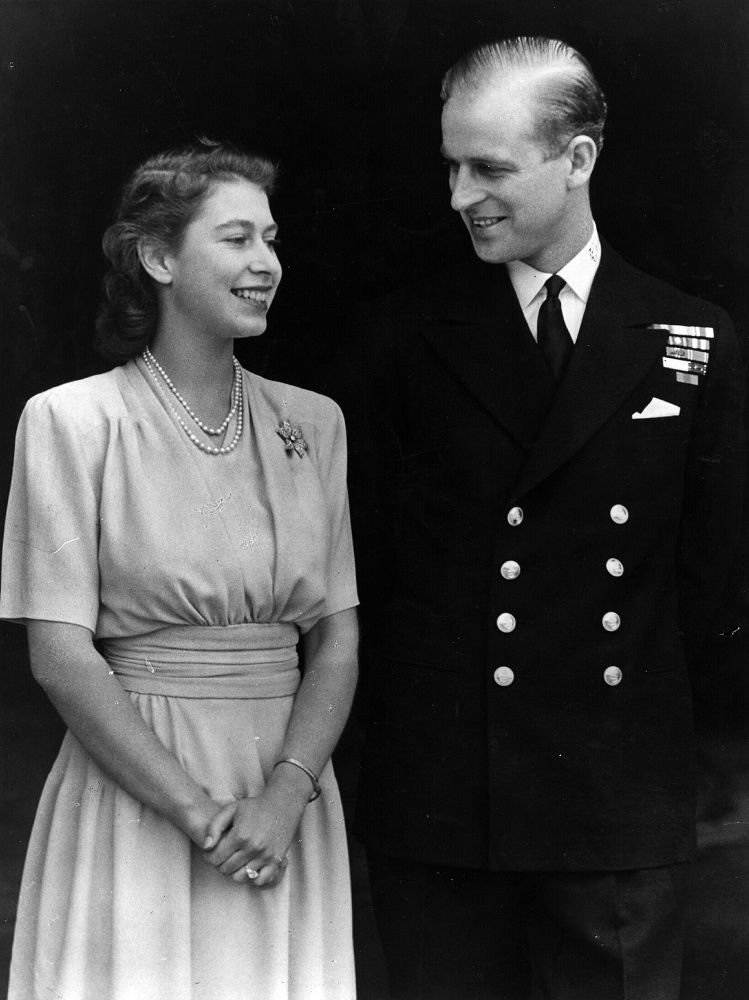 Queen Elizabeth and Prince Philip during their engagement at Buckingham Palace in London, July 1947 | Photo: Getty Images