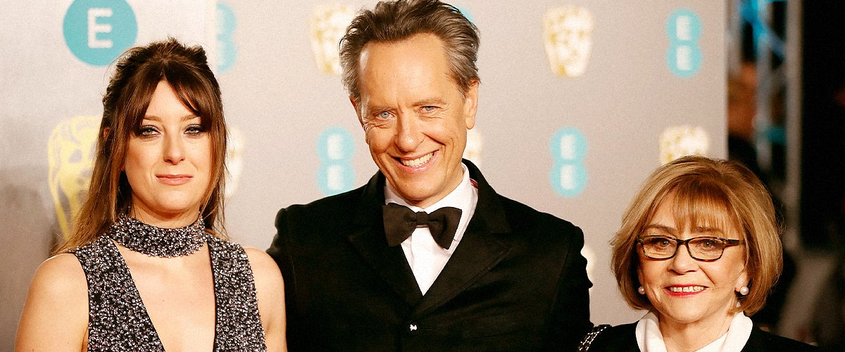 Richard E. Grant on the red carpet with his wife Joan Washington (R) at the BAFTA British Academy Film Awards on February 10, 2019 | Photo: Getty Images