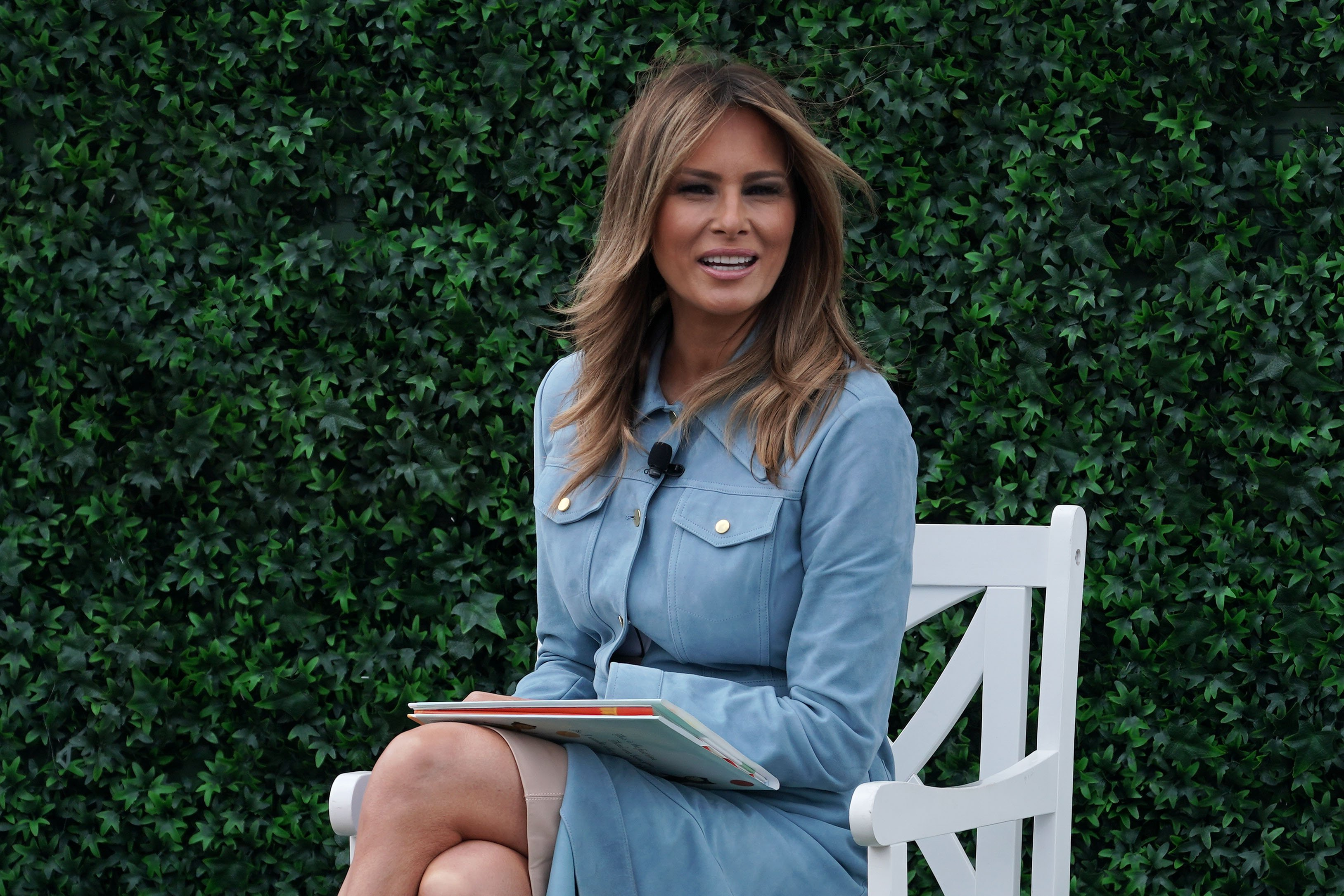 Melania Trump reads a story book to children during the 141st Easter Egg Roll on the South Lawn of the White House April 22, 2019, in Washington, DC. | Source: Getty Images.