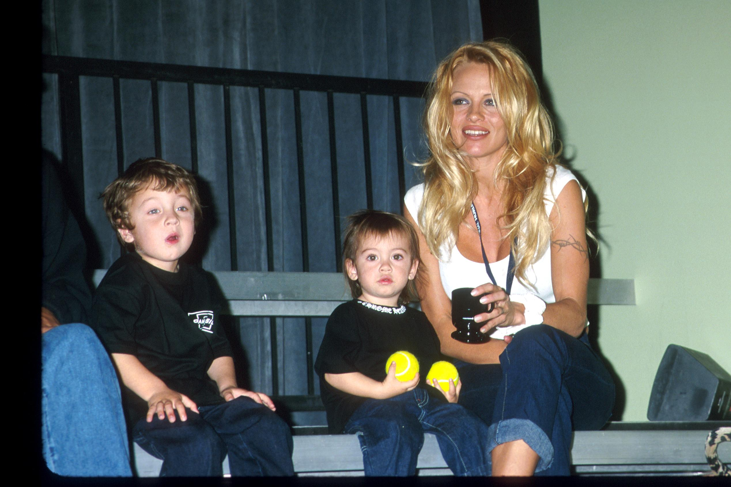 Pamela Anderson Lee with her kids Brandon & Dylan attending the Mtv's BALL2K a new interactive, futuristic game based on the skills of baseball | Photo:GettyImages