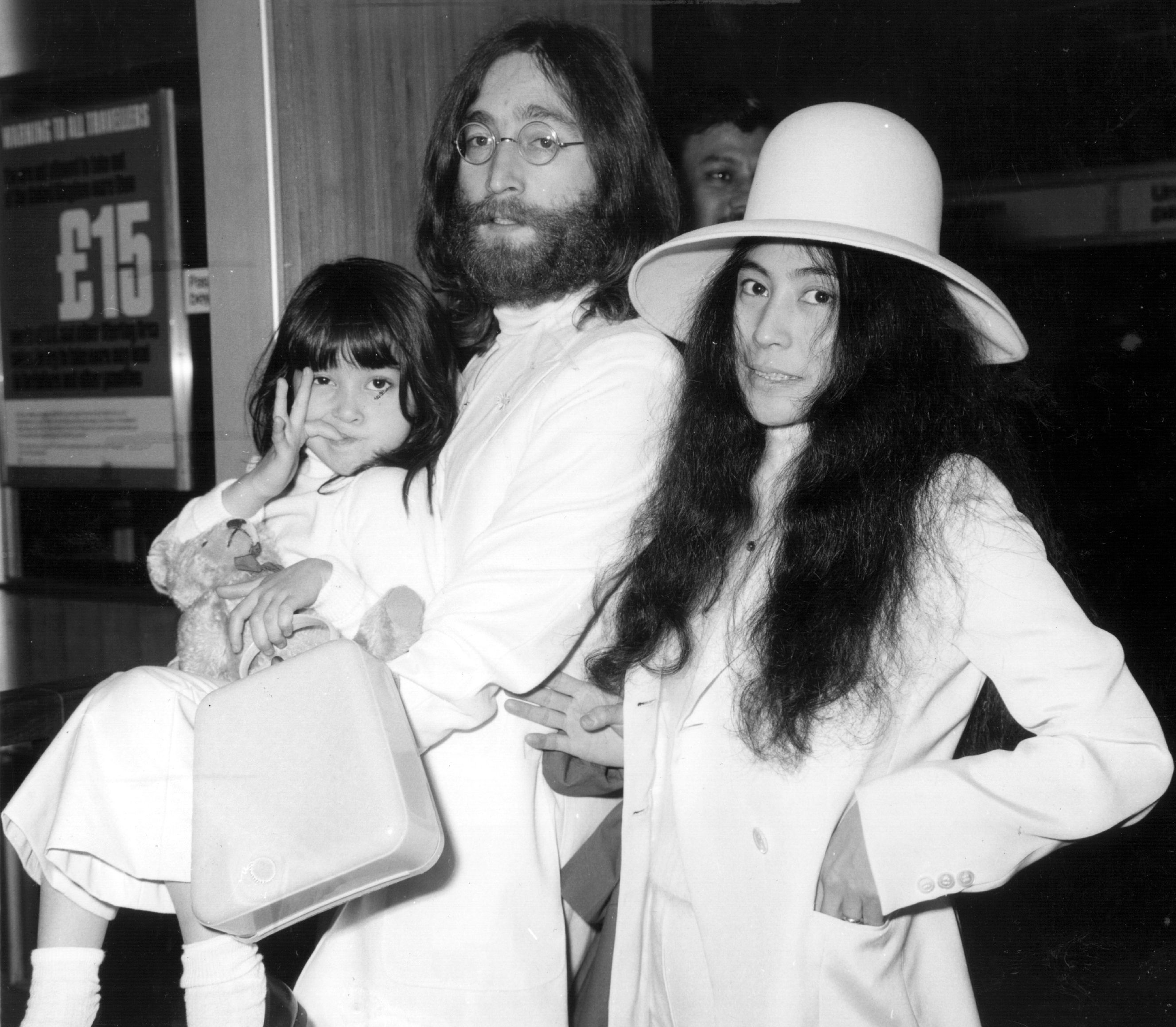 John Lennon and Yoko Ono at London's Heathrow airport with Kyoko in 1969 | Source: Getty Images