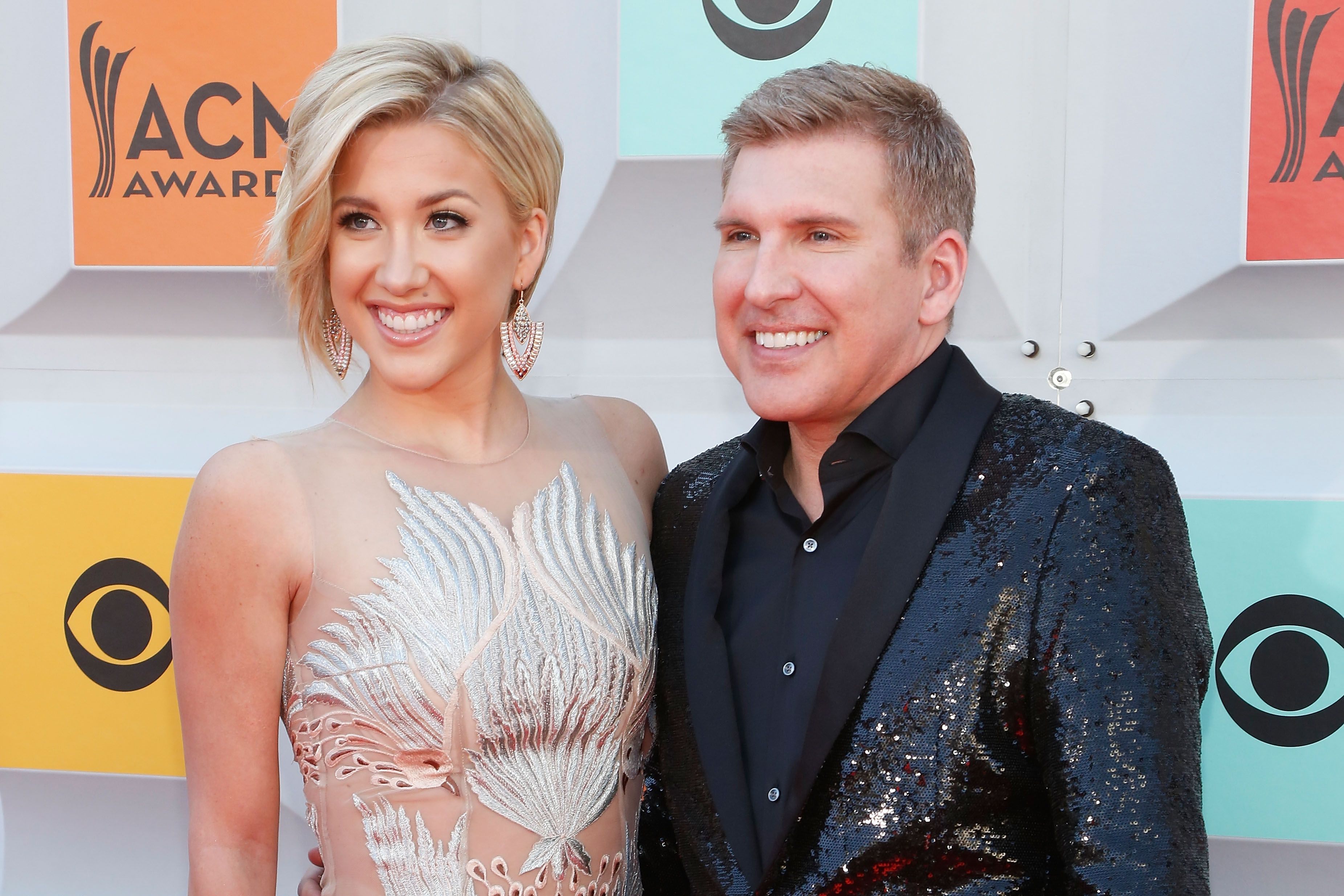 Savannah Chrisley and Todd Chrisley during the 51st Academy of Country Music Awards at MGM Grand Garden Arena on April 3, 2016 in Las Vegas, Nevada.   Source: Getty Images