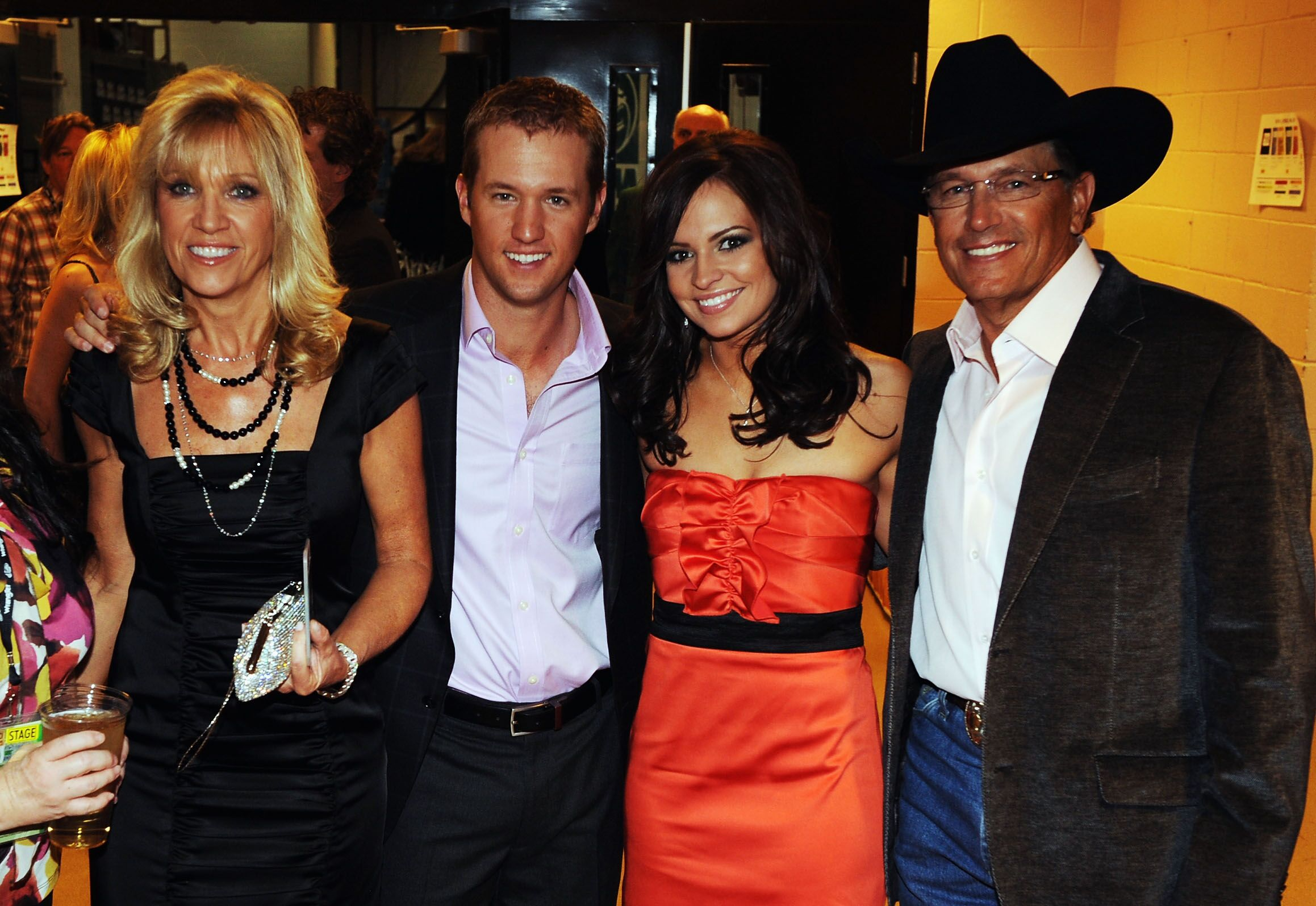 Norma Strait, Bubba Strait, Tamara Shipman, and George Strait pose backstage. | Source: Getty Images