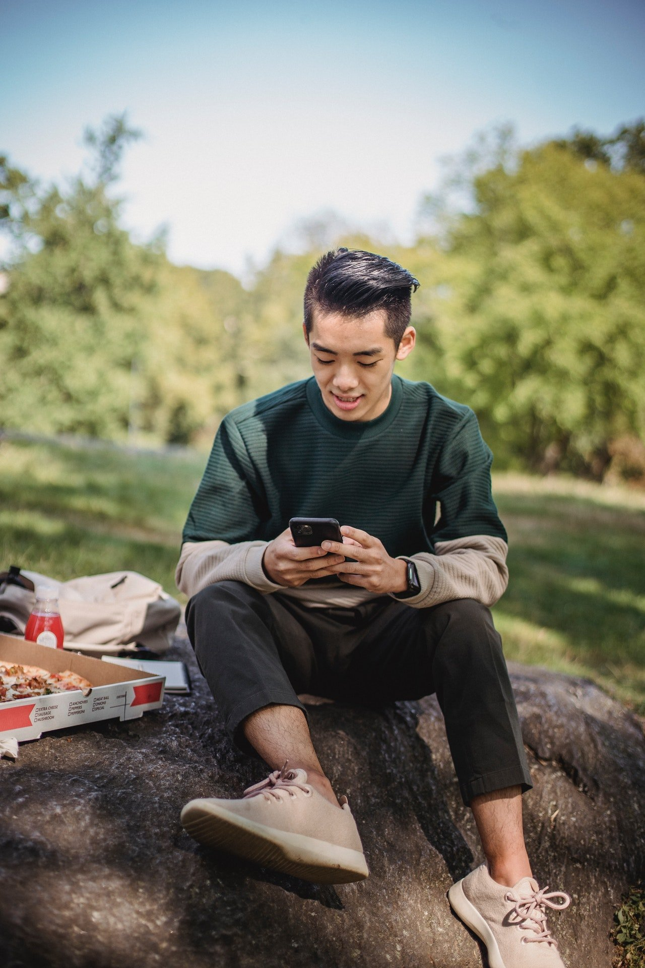 Photo of a man using his phone | Photo: Pexels