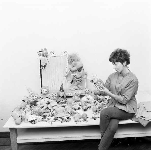 Italian animation artist Maria Perego, inventor of Topo Gigio, looking at a model of the famous puppet. 1960s | Photo: Getty Images