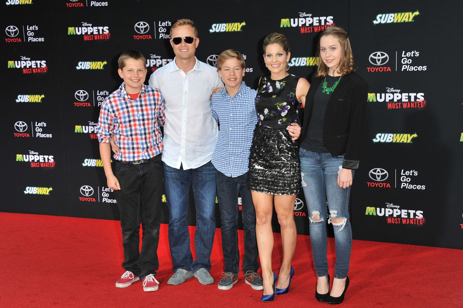 "Candace Cameron Bure and Valeri Bure arrive at the Los Angeles premiere of ""Muppets Most Wanted"" with their children on March 11, 2014, in Hollywood, California 