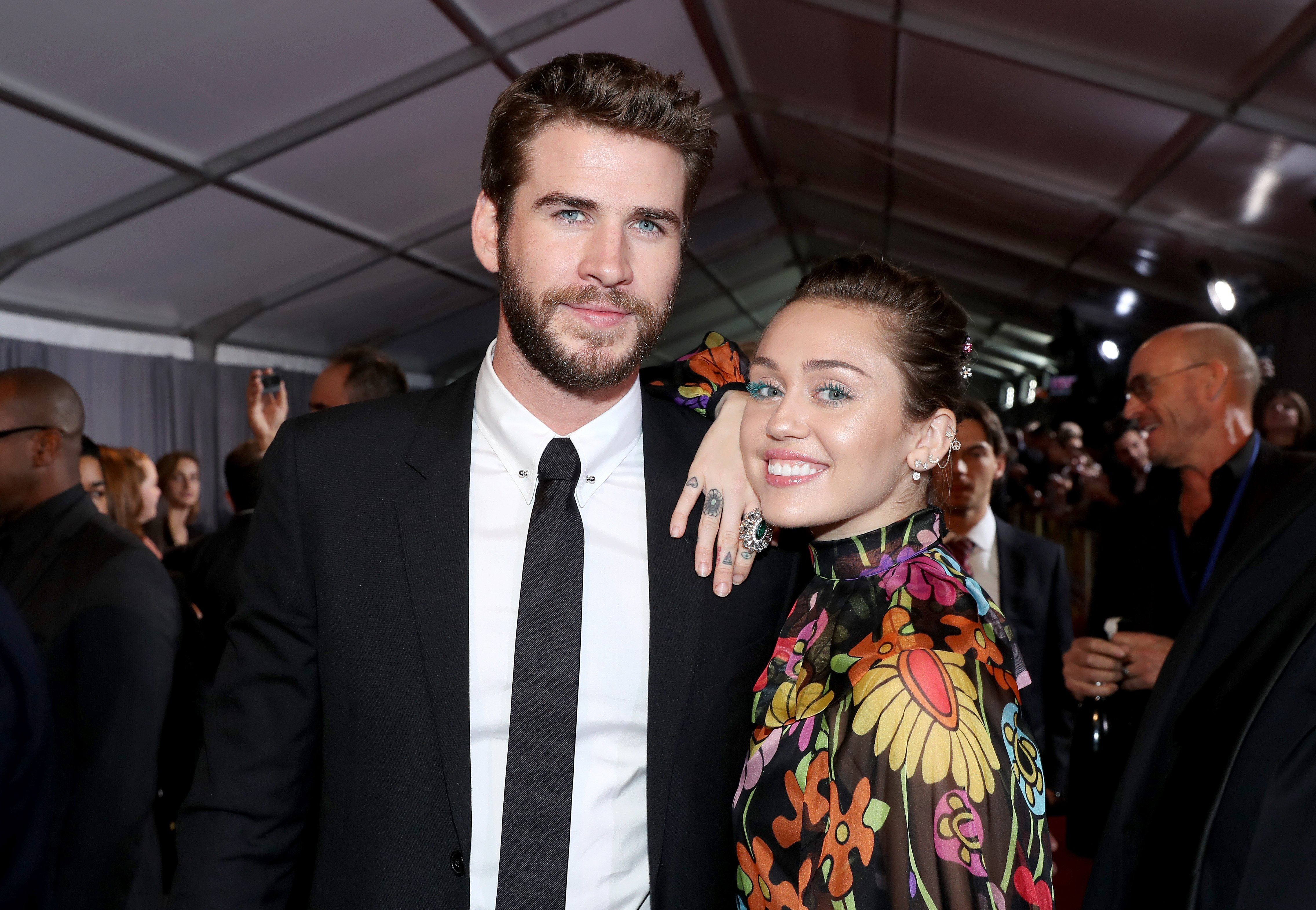 """Actor Liam Hemsworth (L) and Miley Cyrus at The World Premiere of Marvel Studios' """"Thor: Ragnarok"""" at the El Capitan Theatre on October 10, 2017, in Hollywood, California.   Source: Getty Images."""