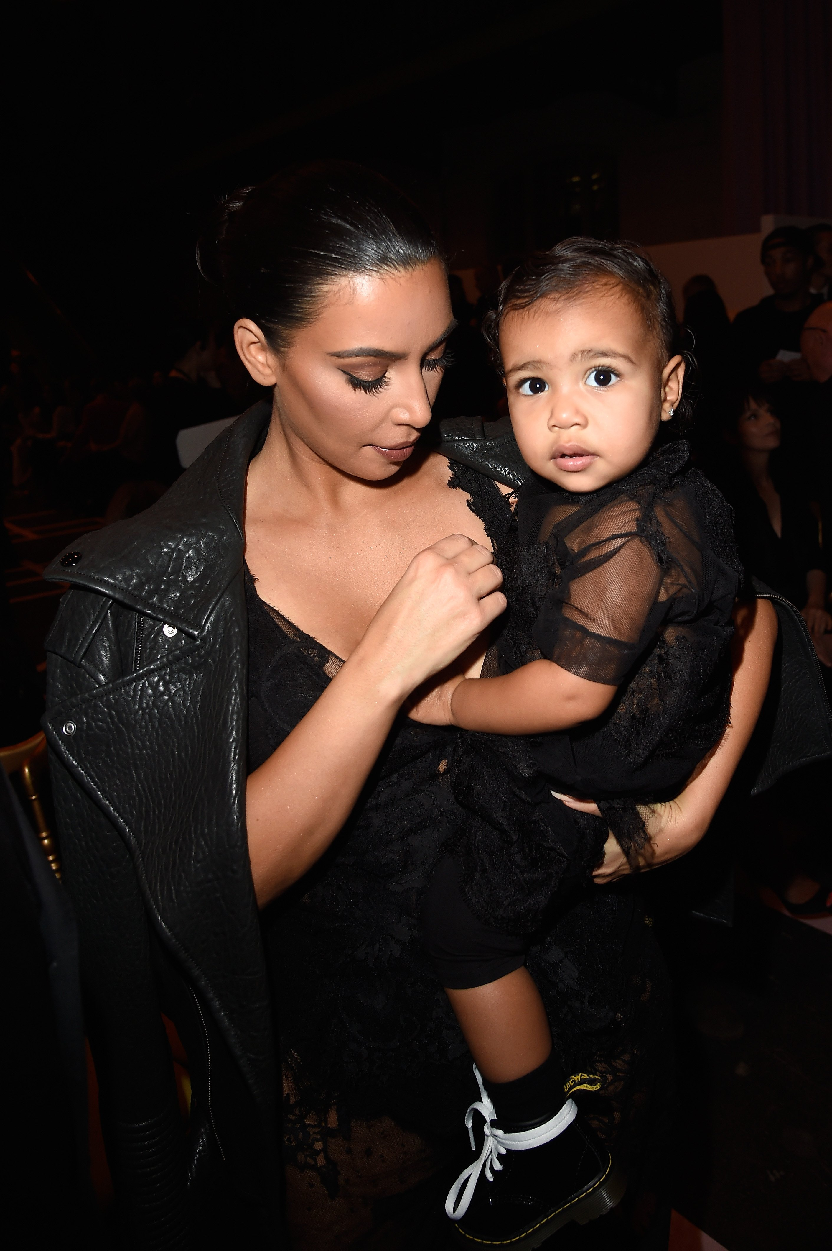 Kim Kardashian and North West attend the Givenchy show as part of the Paris Fashion Week Womenswear Spring/Summer 2015 on September 28, 2014. | Source: Getty Images