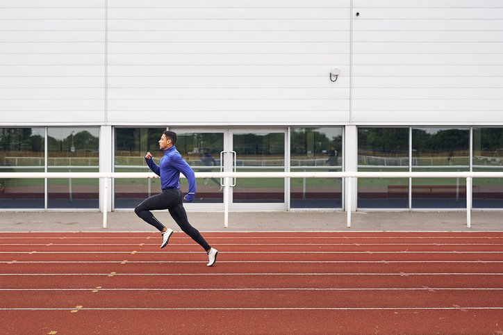 A male runner training on running track | Photo: Getty Images