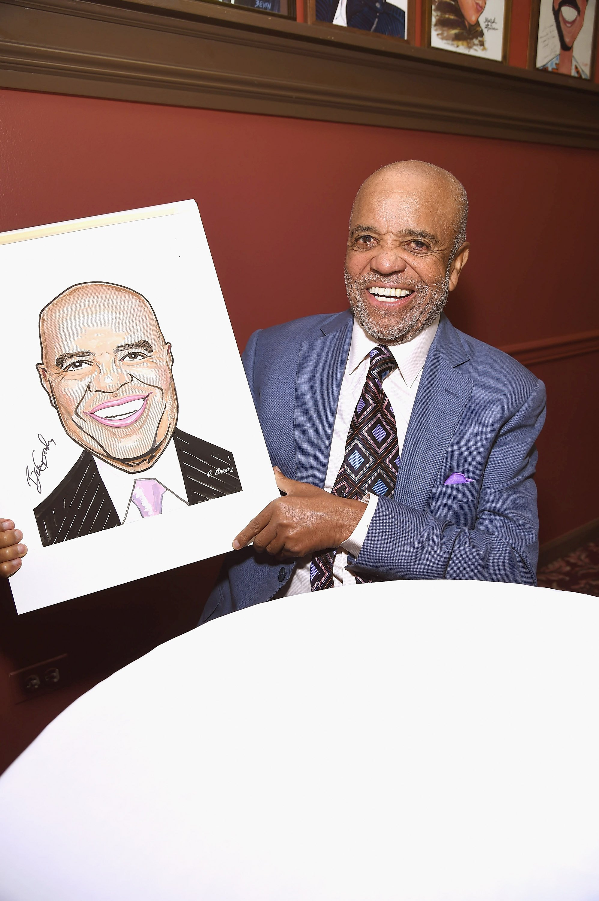 Berry Gordy smiles with his portrait in New York City in July 2016.   Photo: Getty Images