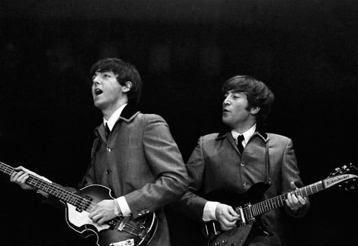 """McCartney and Lennon performing in """"The Beatles"""" during their career. 