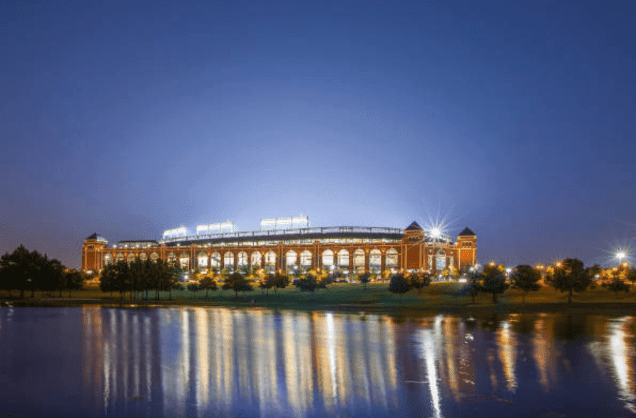 Globe Life Park stadium from a river bed, showing the lights shining bright, at Ballpark in Arlington, Texas   Source: Getty Images