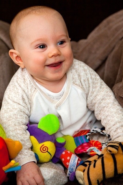 A laughing baby. Image credit: Pixabay
