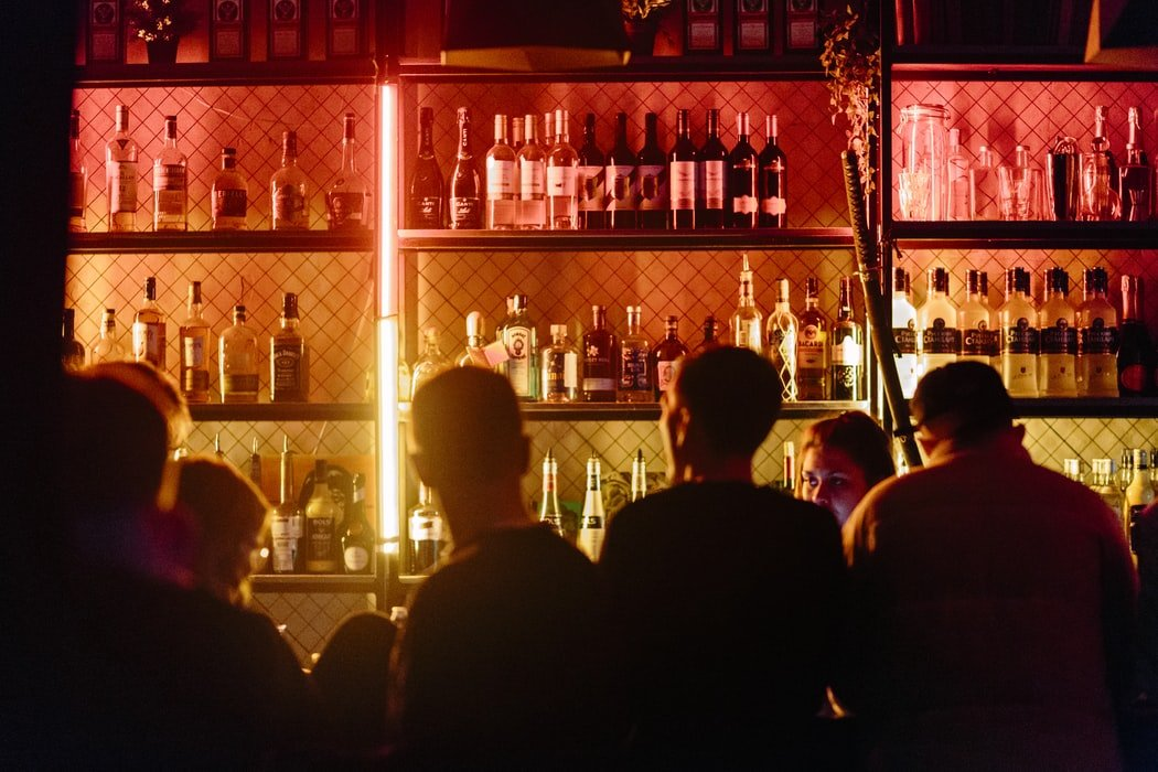 People in a bar | Source: Unsplash