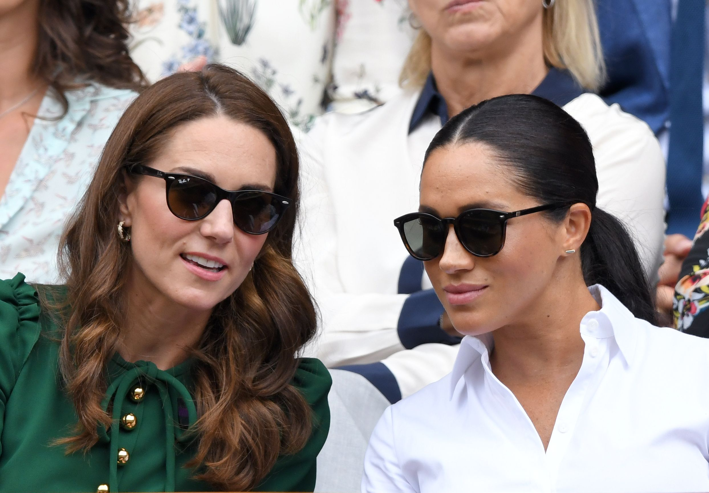 Kate Middleton and Meghan Markle in the Royal Box on Centre Court during day twelve of the Wimbledon Tennis Championships at All England Lawn Tennis and Croquet Club on July 13, 2019 | Photo: Getty Images