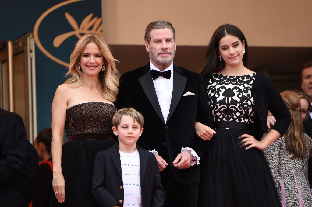 "Kelly Preston (L) and John Travolta of ""Gotti"" pose with their children Ella Bleu Travolta (R) and Benjamin Travolta at the red carpet screening of ""Solo: A Star Wars Story""  