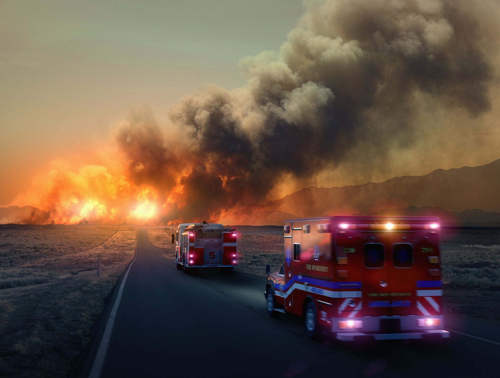 Ambulance driving to forest fire in desert | Photo: Getty Images
