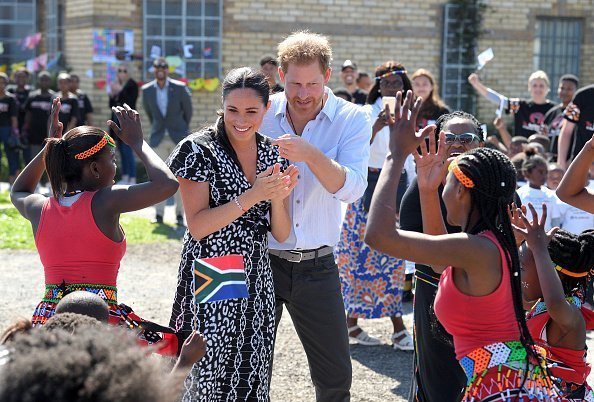 Prince Harry and Meghan visit the Nyanga Township during their royal tour of South Africa | Photo: Getty Images