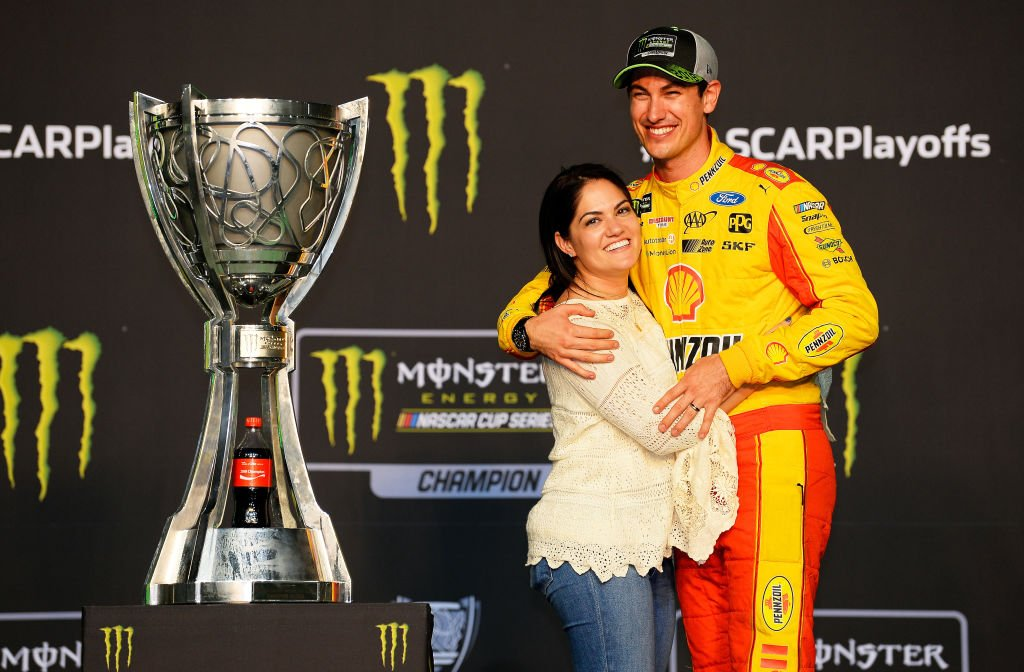 Joey Logano celebrates with his wife, Brittany after winning the Monster Energy NASCAR Cup Series Ford EcoBoost 400 and the Monster Energy NASCAR Cup Series Championship on November 18, 2018 in Homestead, Florida   Photo: Getty Images