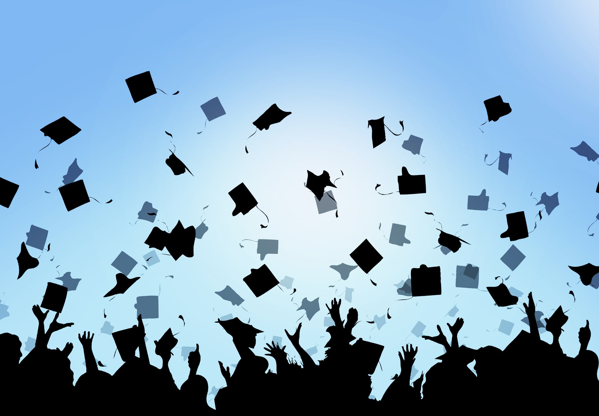 Graduates celebrating as they throw their mortarboards in the air.   Photo: Getty Images
