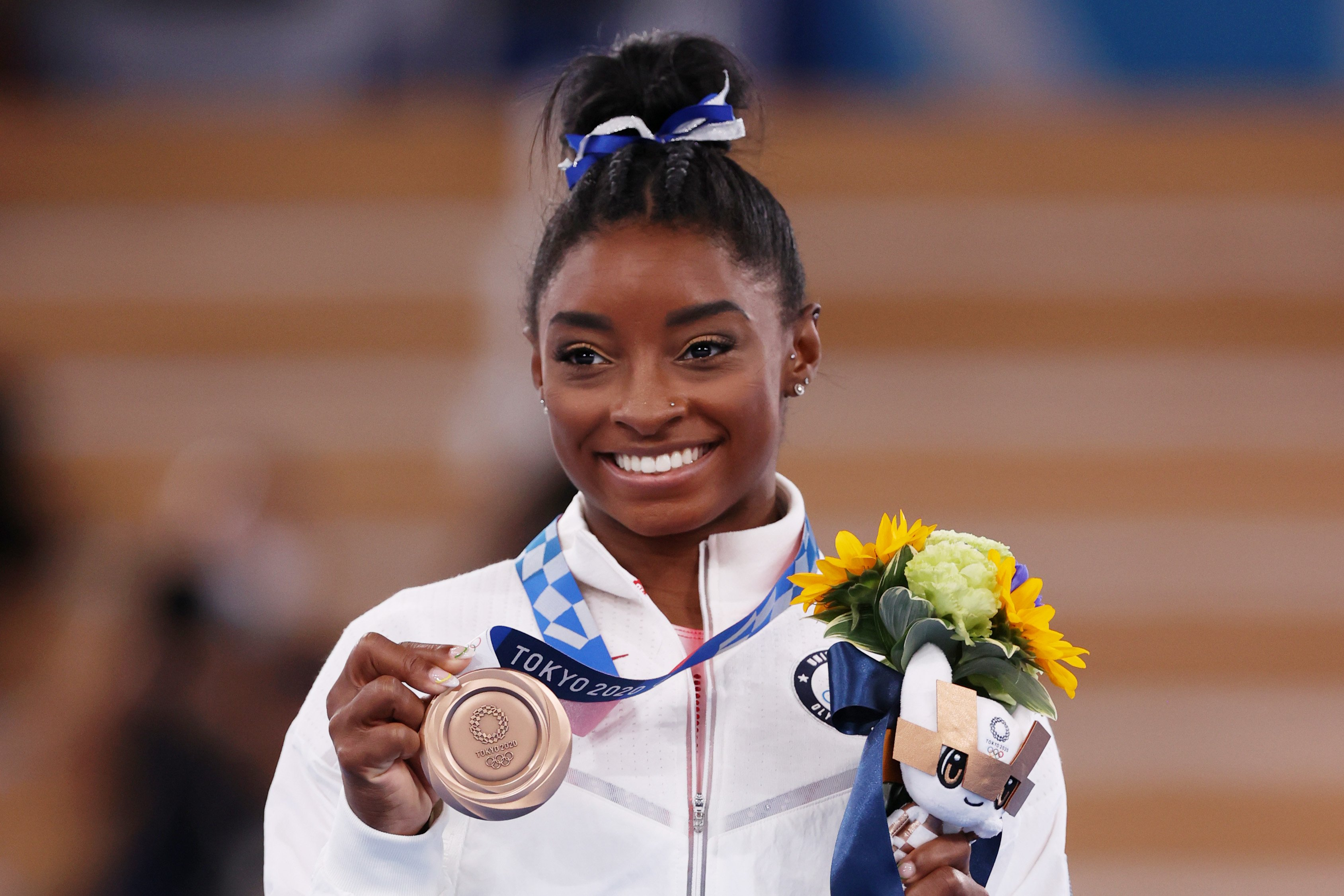 Simone Biles pictured with a bronze medal during the Women's Balance Beam Final medal ceremony in Tokyo 2020 Olympics on August 3, 2021 in Tokyo, Japan. | Photo: Getty Images
