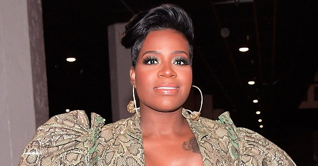 Fantasia's Baby Keziah Poses in a White Dress & Shoes as She Is Finally Brought Home from the Hospital