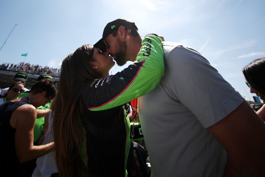 Danica Patrick, driver of the #13 GoDaddy Chevrolet kisses Aaron Rodgers prior to the 102nd Running of the Indianapolis 500 at Indianapolis Motorspeedway on May 27, 2018 in Indianapolis, Indiana. | Source: Getty Images