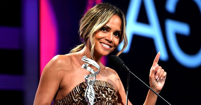 Halle Berry, 54, Stuns in a Bold Look Wearing Revealing Gold Jumpsuit in a Recent Photo