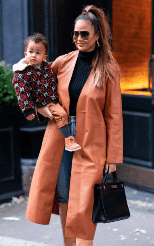 Chrissy Teigen carrying her son, Miles Stephens as she exists from SoHo with her family, on November 23, 2019, in New York City | Source: Getty Images (Photo by Gotham/GC Images)