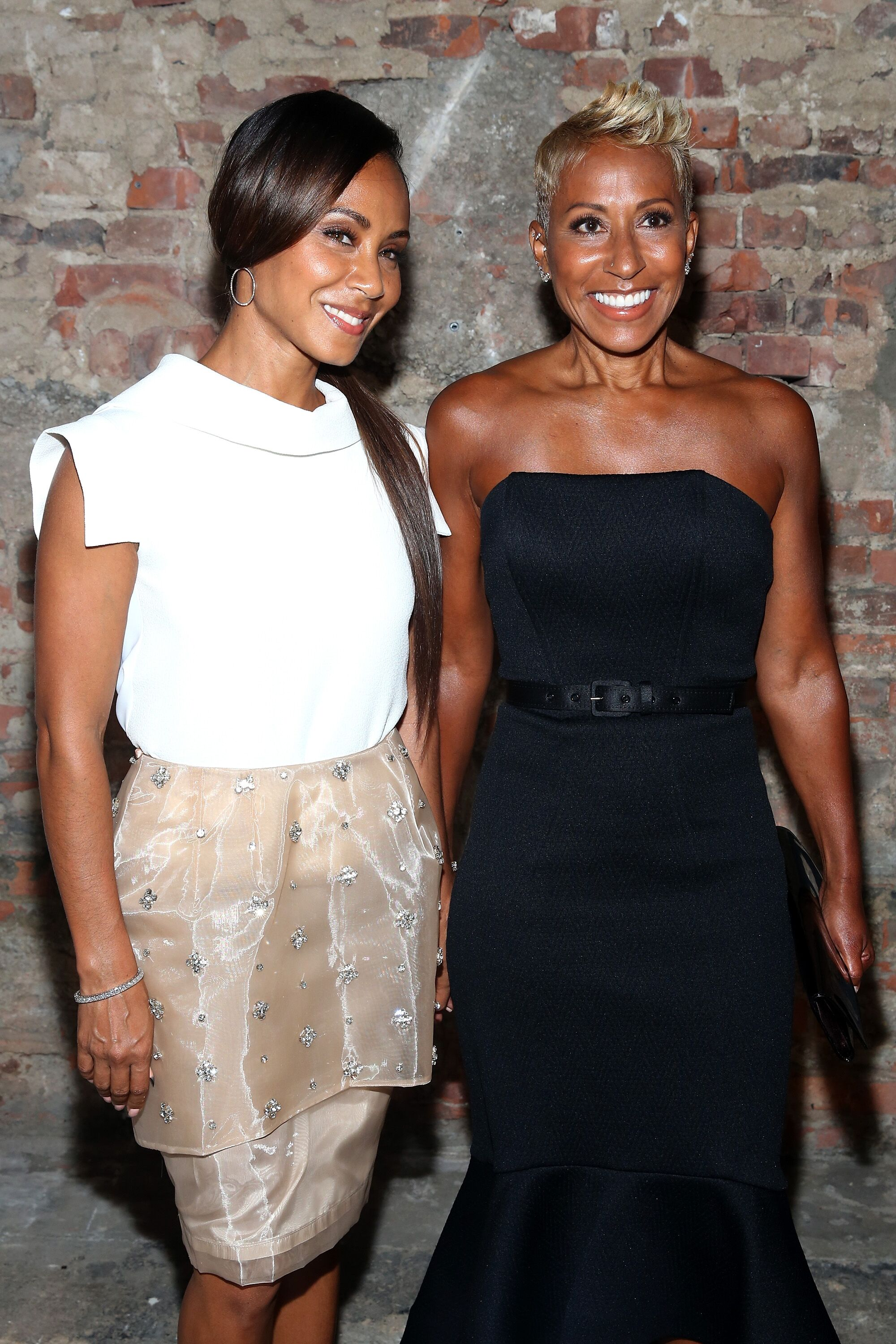 Jada Pinkett Smith (L) and Adrienne Banfield pose backstage at the Christian Siriano fashion show during Mercedes-Benz Fashion Week Spring 2015 at Eyebeam on September 6, 2014 in New York City | Photo: Getty Images