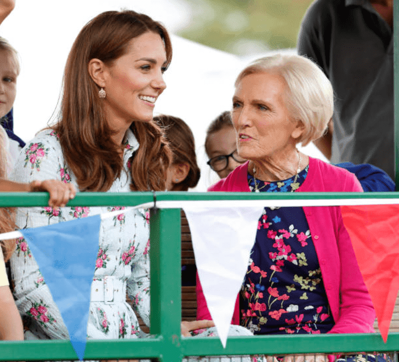 "Kate Middleton and Mary Berry sit in a tractor as they arrive at the ""Back to Nature"" festival at RHS Garden Wisley, on September 10, 2019, in Woking, England 