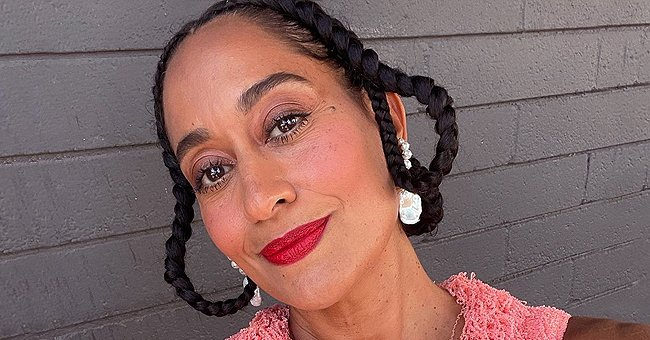 Tracee Ellis Ross Tightens Her Thin Waist with Gold Belt Posing in Khaki Pants in Fashion Shoot