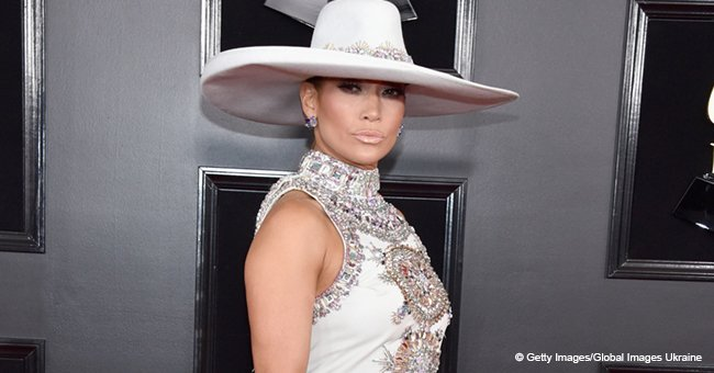 Jennifer Lopez Wows Wearing a Deep Back-Slit Dress and an Enormous Hat for the Grammy's