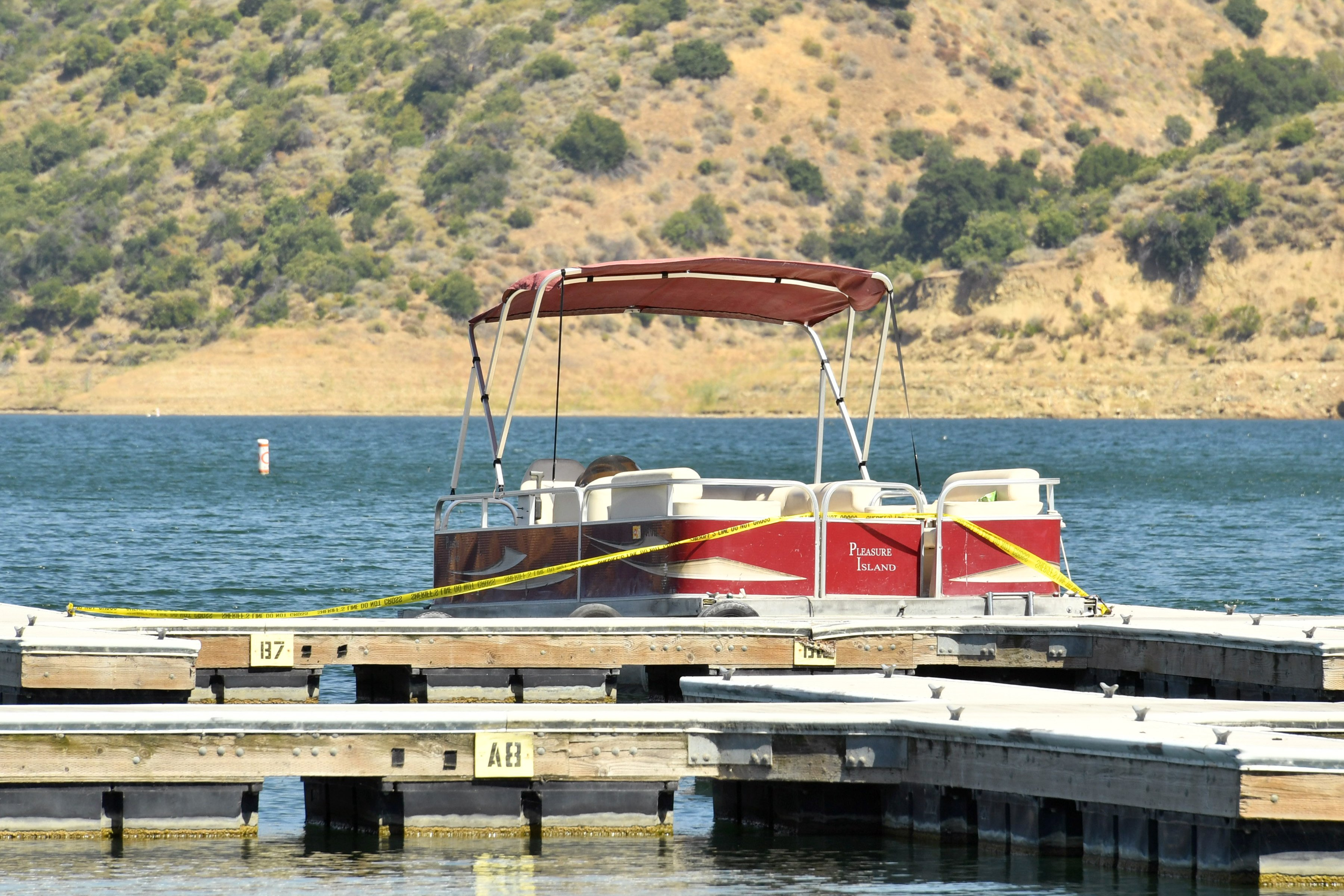 A boat is docked and roped off with police tape at Lake Piru, where actress Naya Rivera was reported missing Wednesday, on July 9, 2020, in Piru, California. | Source: Getty Images.