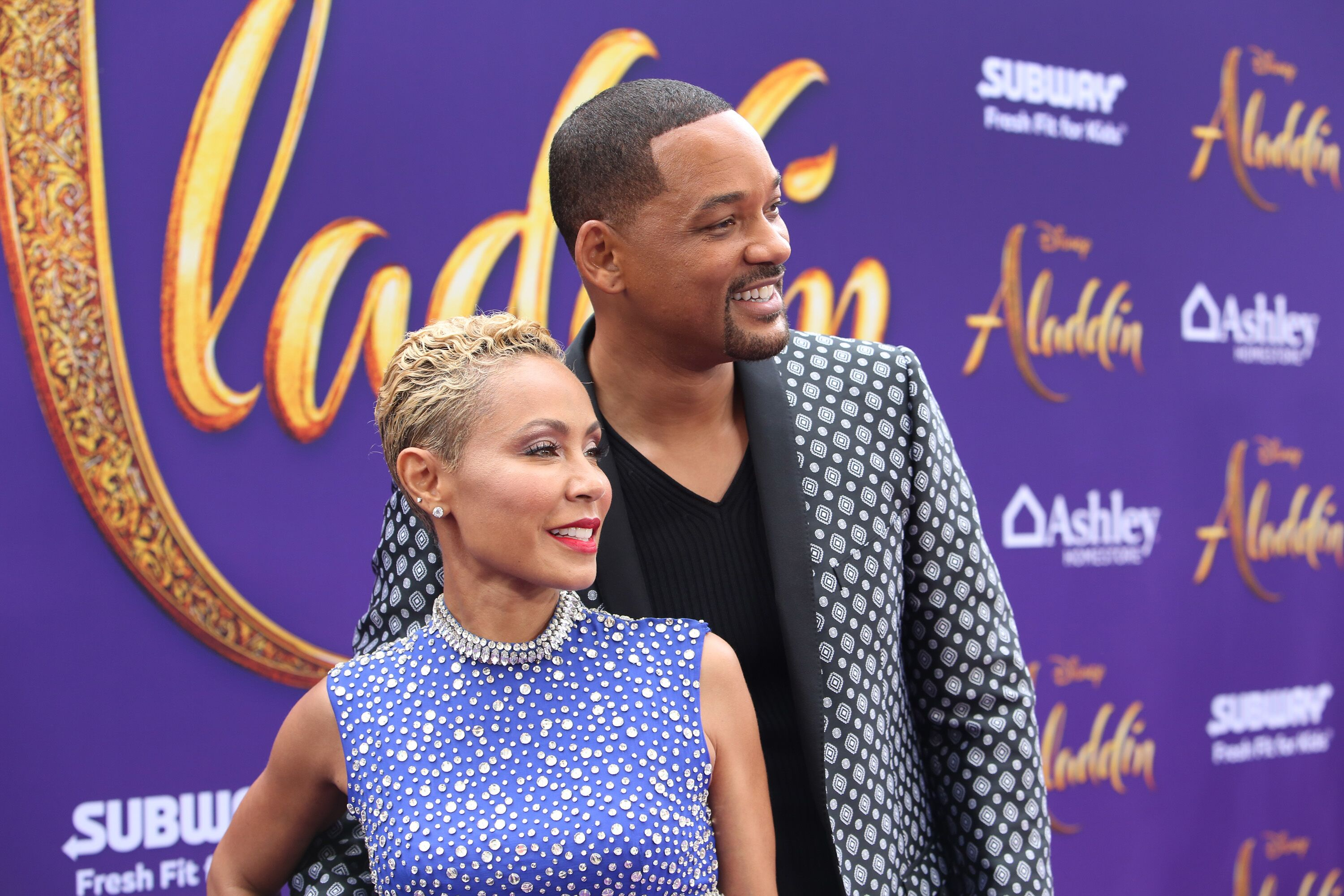 """Jada Pinkett Smith (L) and Will Smith attend the World Premiere of Disney's """"Aladdin"""" at the El Capitan Theater in Hollywood. 
